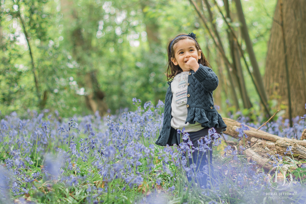 Essex Bluebelle mini session mother and daughter little girl laughing amongst the bluebells