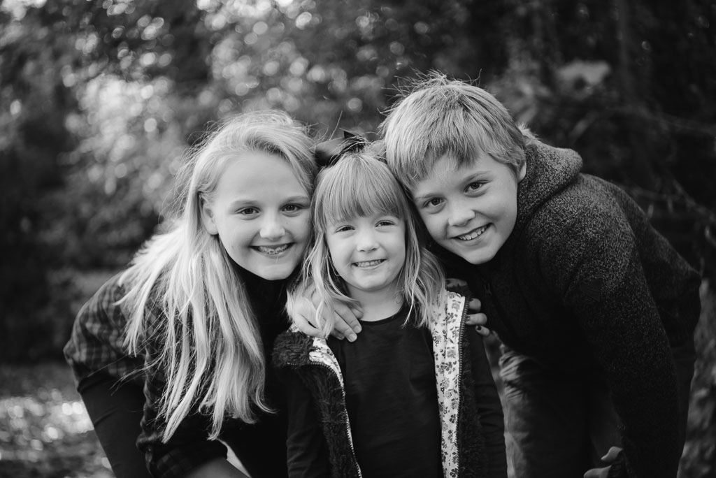 black and white portrait of 3 children