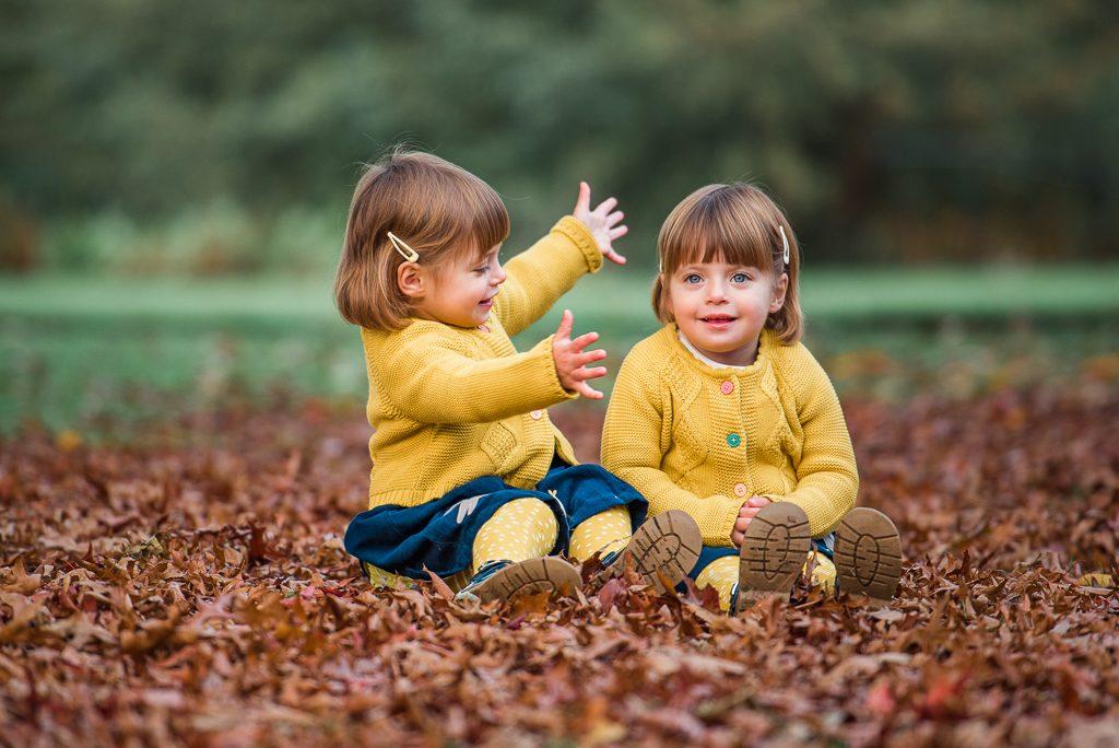 Twin sisters hugging outdoor photoshoot